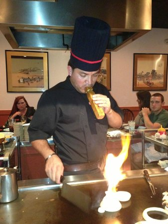 Jinbeh: Chef blowing a train whistle
