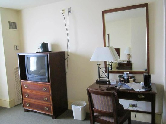 The Boston Common Hotel and Conference Center: Dresser and tv set in the room.