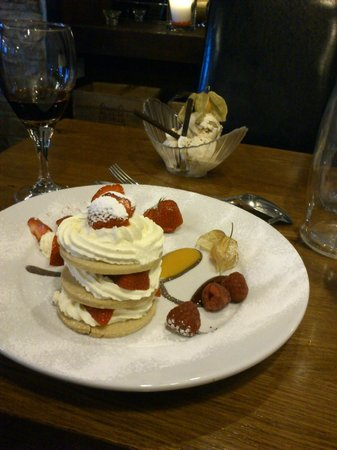 The Old White Lion Hotel Restaurant: dessert: strawberry shortcake (front) maple & walnut icecream (back)