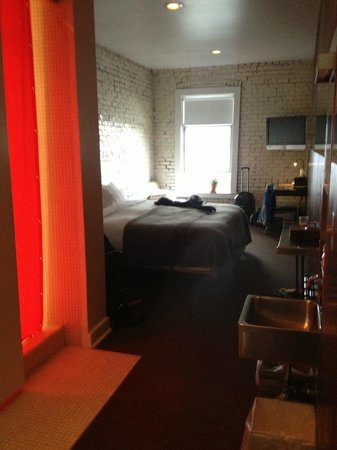 Ace Hotel: the room from the door, the roomy double shower is behind the red curtain
