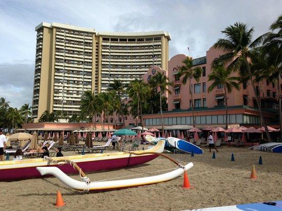 The Royal Hawaiian, a Luxury Collection Resort: Exterior of Royal Hawaii dwarfed by Sheraton Waikiki