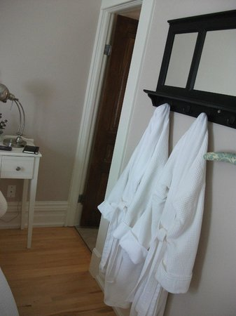 Silken Retreat: Bedroom with white robes provided