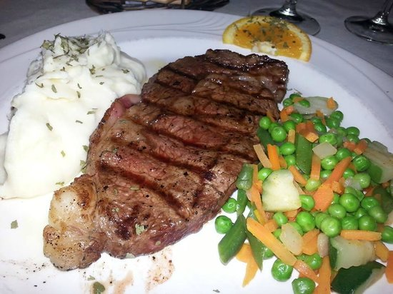 Halcyon Days: Dinner Special: 8-oz. Ribeye Steak with all the trimmings for $13.99