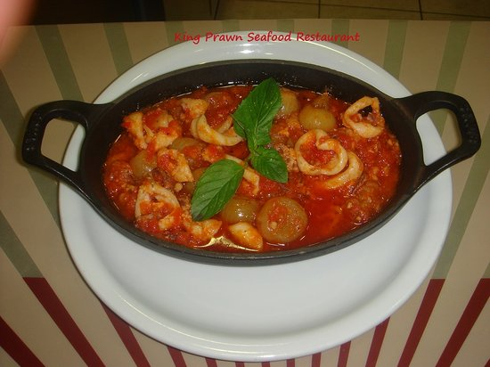 King Prawn: Calamari Stifado...baked with fresh tomato, onions and herbs
