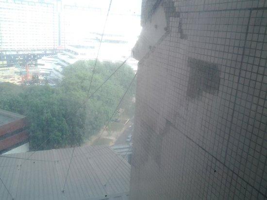 Furama City Centre : view through the mouldy window