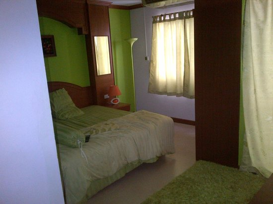 Baan Suk-Kho Boutique Inn: очень уютная и стильная зеленая комната