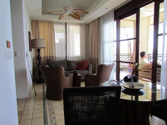 Arenas del Mar Beachfront & Rainforest Resort: One of several seating areas and out to the balcony