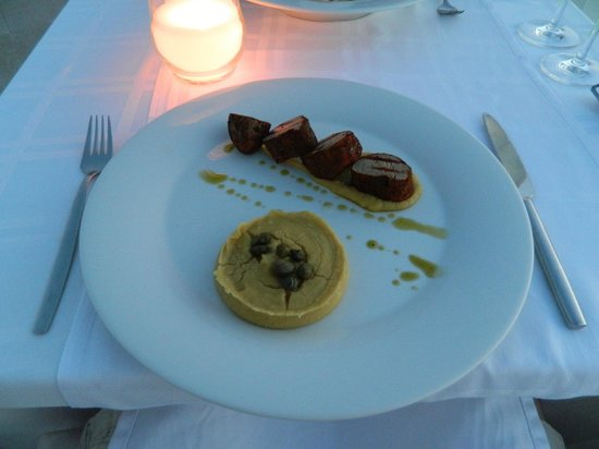 Above & Beyond Restaurant: The pork with traditional Santorinian Fava