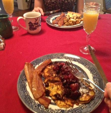 Red Elephant Inn Bed & Breakfast: A bad phone photo of our main course for breakfast. I have orange pancakes, my girlfriend had qu
