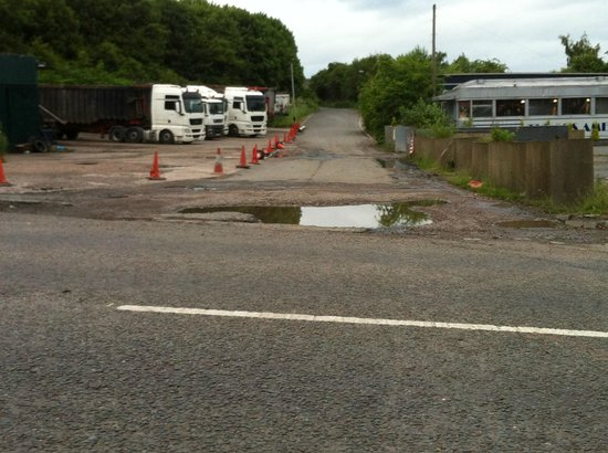 50's American Diner: The huge potholed road with a truckers wagon park