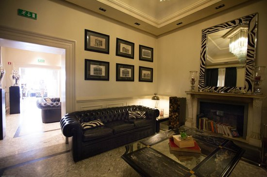 Hotel Isa: One of the Lounge Areas in the Lobby