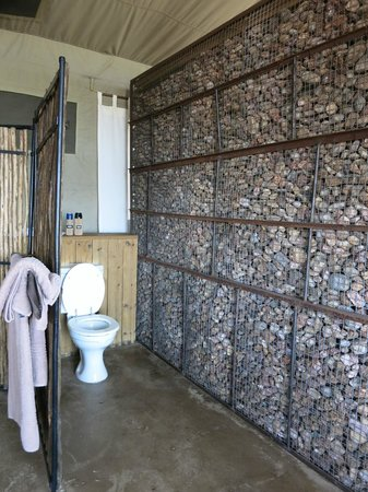Lovely Wilderness Safaris Ruckomechi Camp: This Rock Wall Separates The Toilet  From The Bedroom. Its