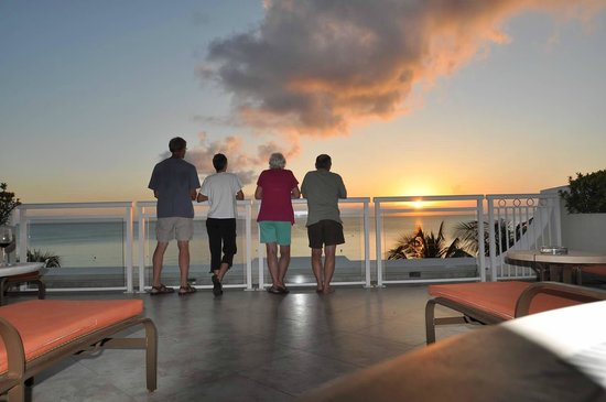 Beachcomber Grand Cayman: Watching the sunset from our deck at Beachcomber Condos