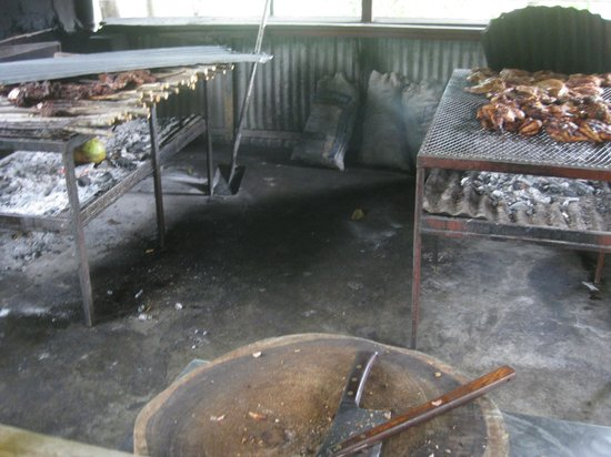 Pork Pit: View of the meats cooking. Pork on left chicken on right