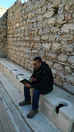 Apasas Tours : Nizam sitting on an ancient toilet..