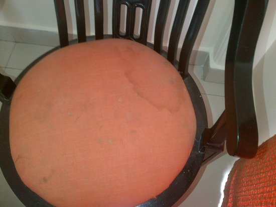 Mussoorie Gateway: Stained Chair in the room