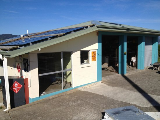 Matiu / Somes Island : Solar panels on roof with shadow of the wind turbine and the prototype electrolyser (hydrogen ge