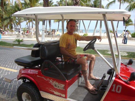 Hotel Posada Del Mar : Chris in our golf cart in front of Posada del Mar