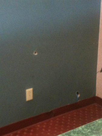 Travelodge Knoxville East : Lobby Photo of hole in wall.