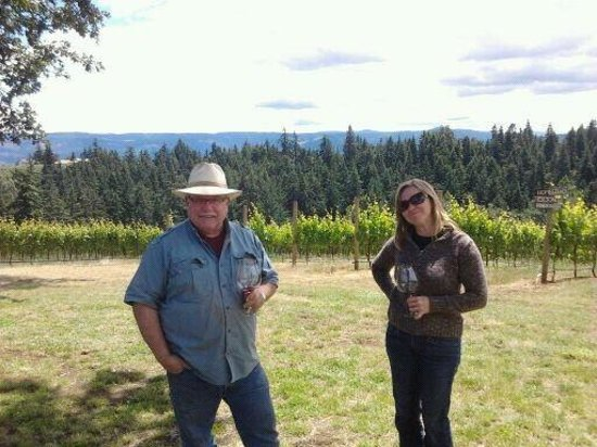 Phelps Creek Vineyards: proprietor Bob sips wine in the vineyard with a guest