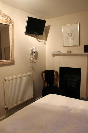 The Henry Guest House: The left side of the room including TV and hair dryer