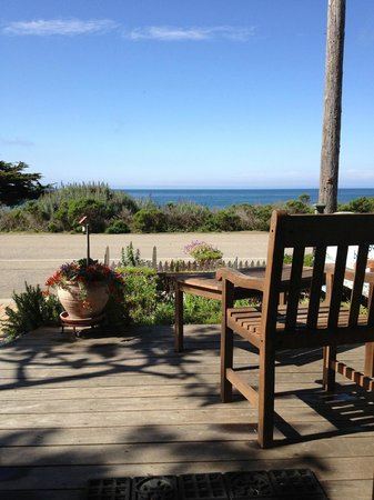 Moonstone Cottages: On the patio of Seascape Cottage, where we ate breakfast and had our wine