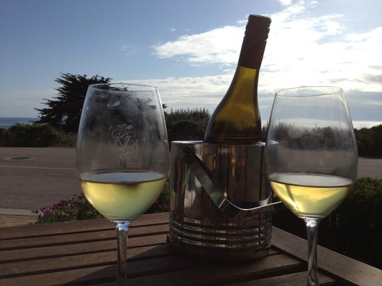 Moonstone Cottages: A bottle of wine and a view of the ocean on our patio at Seascape