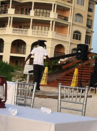 The Somerset on Grace Bay: beach bbq server dancing w/tray on head