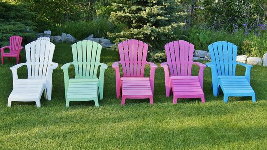 "Coachlite Inn of Sister Bay: Colorful chairs invite guests to join a ""sit in"" in front, smores in back firepit."
