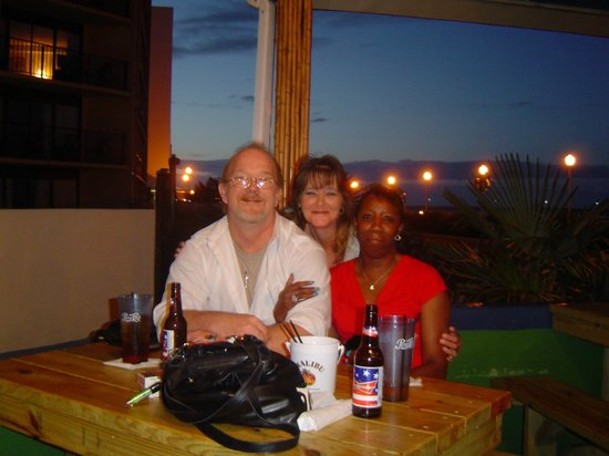 Calypso Bar and Grill: me and wife with traveling friend (evening)