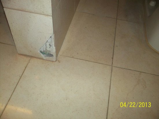 Bathroom tiles stains and missing picture of luxor las for How to remove yellow stains from bathroom tiles