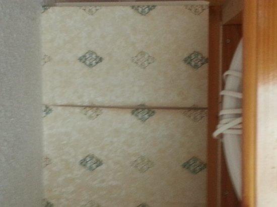 The Inn on the Lake: peeling wallpaper over wardrobe