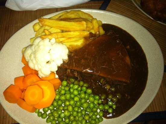 The steak pie served with delicious chunky chips and tasty ...