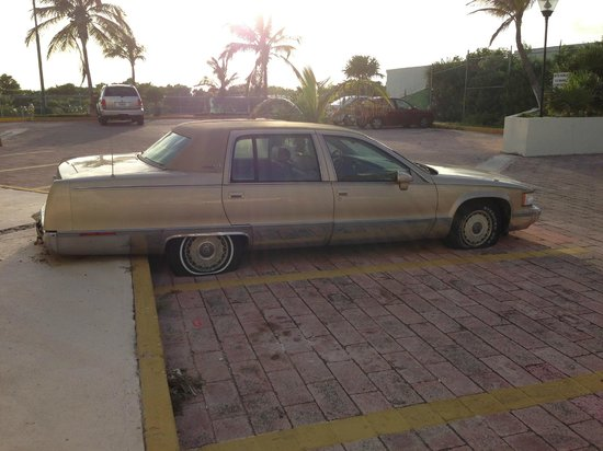 Solymar Cancun Beach Resort: This photo says it all.  Run down place.  This car was in the parking lot and typifies the condi