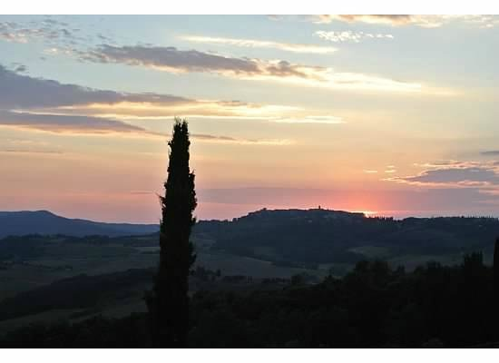 Castello di Casole Private Estate & Spa: sunset over distant town from the hotel