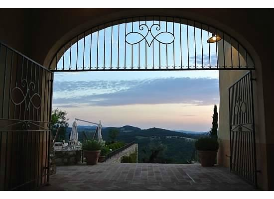 Castello di Casole Private Estate & Spa: leaving the central courtyard for the heart of the view from pool and ourdoor restaurant seating