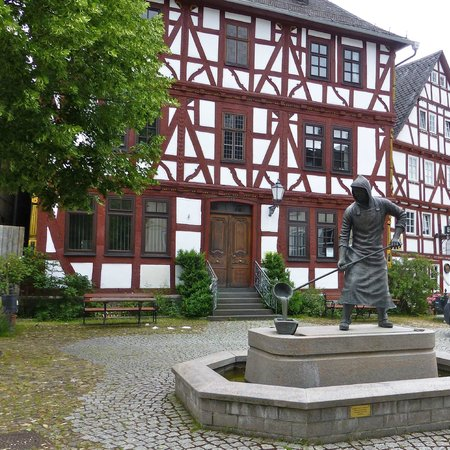 Wilhelmsturm: Half timber house - statue of miner (ore)