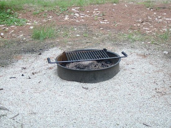 Woodmore Campground: The fire ring on our sites, also available are sites with ADA Rings