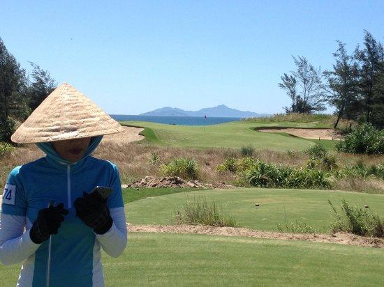 Danang Golf Club: Caddie, South China Sea and hole 16
