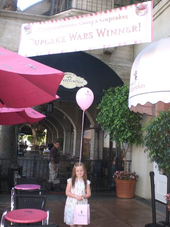 Casey's Cupcakes at the Mission Inn: banner announcing their cupcake war winner fame