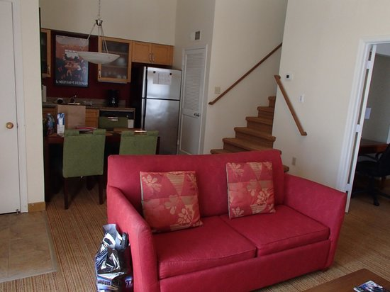 Living room with kitchen in background. - Picture of Residence Inn ...