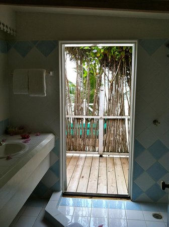 Cocobay Resort: Doors open from our shower to the deck. Loved showering in the warm Caribbean air!