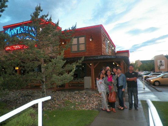 Montana's BBQ & Bar: family photo infront of the Montanna Restaurant, Calgary, AB, Canada