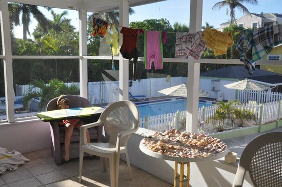 Beachview Cottages: View of pool from porch of #22