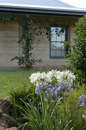 The EarthHouse: EarthHouse sits amongst beautiful lawns and gardens.