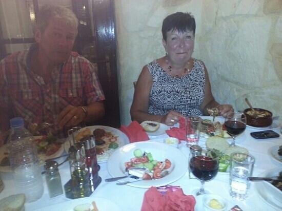 mum and dad in minos enjoying the amazing food