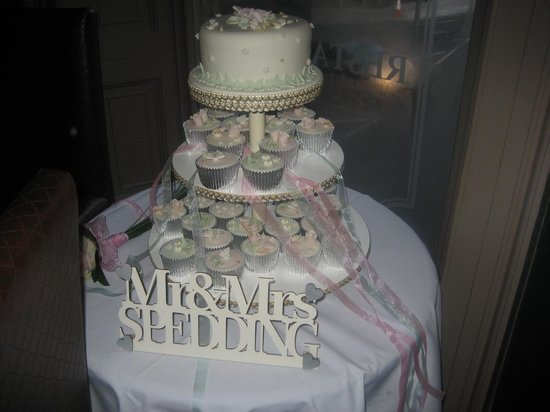 Our wedding cake in the window of Shambles
