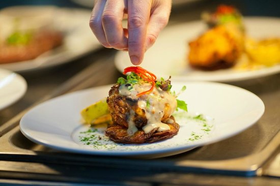 The Bistro Grill: Chef plating up in the Grill