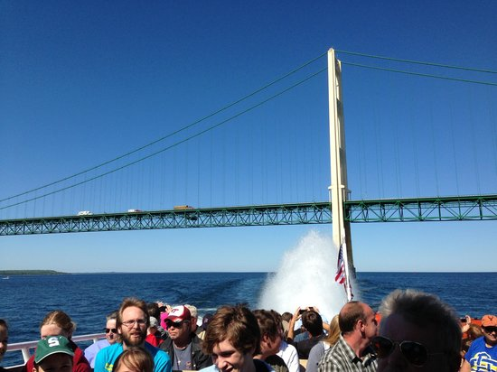 Star Line Mackinac Island Hydro-Jet Ferry: some of the crowd on the boat and the fan tail behind us & the Mackinaw Bridge!