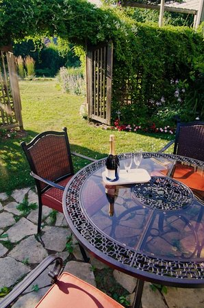 AquaBella B&B: A glass of wine on the patio...